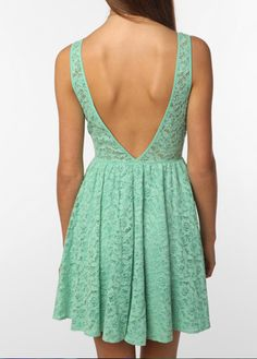 Sweet lace, daring open back in a unique mint hue -- beware of overpowering accessories, this dress speaks for itself