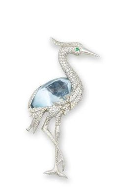 An Aquamarine, Emerald and Diamond Brooch Designed as a crane, set throughout with brilliant-cut Diamonds, to a detachable Aquamarine cabochon, accented by an Emerald cabochon eye, mounted in 18k white Gold, Aquamarine approximately 66.50 carats, Diamonds approximately 4.90 carats total, brooch length 10cm.