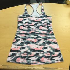 Lululemon Pink Camo Racerback Tank Size 6 Perfect condition. Only worn three times. lululemon athletica Tops
