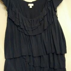 """J. Crew Tiered Ruffled Top, Size Medium Very cute ruffled top. Fabric is viscose, feels like soft cotton. Note photo: plastic seam tape is used around the arm openings. This is not a defect. Gently used top in very good condition. Machine wash and dry. 27.5"""" from shoulder. Fits 36-39 bust. Stretches. 18"""" arm pit to arm pit. J. Crew Tops"""