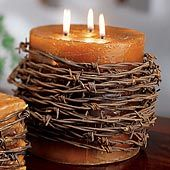 Barbed wire candle for centerpieces? Maybe not as much barbed wire and a white candle.. perfect!