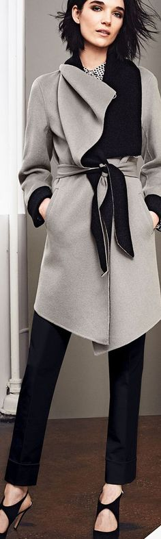 The taupe and black look great together. The shape/drape of the coat looks effortless and stylish.