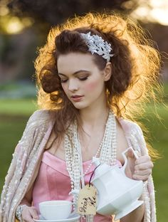 the hair piece, pearls, teacup, dress color, the photo- i <3 everything!