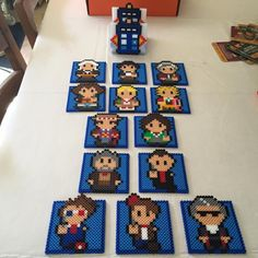 Dr. Who coaster set, with all 13 doctors. The Standing Tardis is the coaster holder. Each coaster is lined on bottom with felt for absorption/help with slippage.