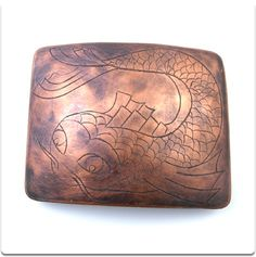 """Koi Buckle  $150.00    hand engraved.  3.5"""" x 2.5"""".   copper.   fits up to 1.75"""" belt. Jewellery handcrafted in Canada by Andes Cruz Designs. Available thru http://andescruzdesigns.com . All designs and images are © Andes Cruz. Quality, original, and built to last. Each piece is one of a kind."""