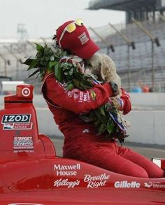 Indianapolis 500,  winner  Dario Franchitti ,  hugs on of  his dogs during the winning car photo shoot  May 28, 2012,  at  The Indianapolis Motor Speedway. Greg Griffo/ The Star