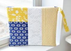 Quilted Zipper Pouch Tutorial - Simple Simon and Company.  Here is the link:  http://www.simplesimonandco.com/2014/05/quilted-zipper-pouch-tutorial.html