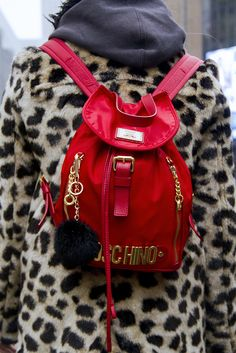 It's really no surprise that everyone's hooked on Moschino because the Italian luxury label hits the right notes of irony, subversion and on-point style. Want an example? Look at this Fashion Week show-goer wearing a teeny tiny scarlet-red Moschino rucksack with bright gold hardware and oversized zips, which perfectly contrasts with her leopard-print coat and hoodie. Winning.