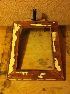 reclaimed wood turns in to wooden frame.