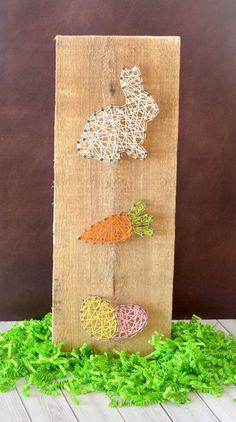 Auf Holz Bilder aus Nägeln und Garn herstellen