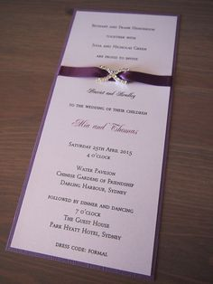This wedding invitation called Plum Diamond has been made using textured purple backing card, pearlescent white text paper, 9mm wide plum purple satin ribbon and a stunning diamante crystal buckle (made using high quality Czechoslovakian crystals). It comes with a matching pearlescent white envelope. (https://www.etsy.com/listing/152867494/plum-diamond-wedding-invitation)