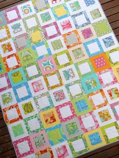 The the mixing of primarily white + a few other solids with the Amy Butler Soul Blossoms.  I wish I'd made this!