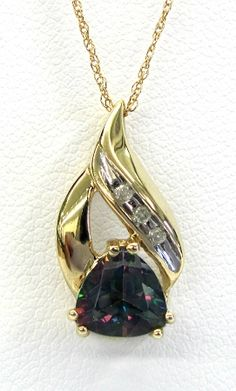 Ladies 10kt yellow gold gemstone and diamond pendant. Mounted in pendant is a created trillion cut mystic topaz and 3 brilliant round cut diamonds weighing approximately .01ct. Pendant comes with an 18 inch yellow gold chain.