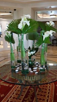 We brightened The Ritz-Carlton Orlando, Grande Lakes Spa with this display of gorgeous white calla lilies, aspidistra leaves, and fan palm.