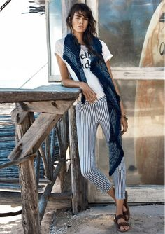 The pin-stripped pants and loosely draped scarf pairing by Mango is casual chic.
