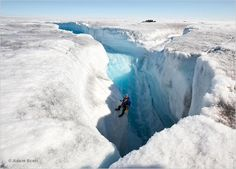 Just your typical work day as a Frozen Planet camerawoman. [Justine Evans abseils into a moulin, a gigantic crack in the ice down which meltwater tumbles on the Greenland Ice Sheet.]