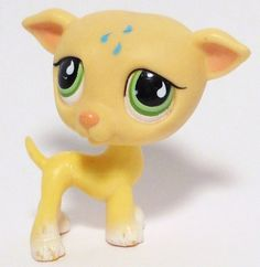 Littlest Pet Shop LPS light tan/cream/beige Greyhound dog 875 with green eyes and 3 bluish-green