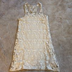 Sleeveless cream Lace Dress This is a sleeveless lace dress with a full lined sheath underneath. T-back. Size XS. Lace dress 100% cotton. Lining 100% polyester. In gently used condition. Lauren Conrad Dresses