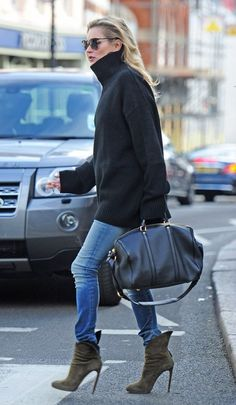 Kate Moss in oversized black sweater, jeans and booties - London, October 2014
