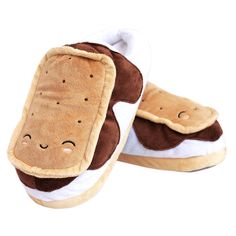 b007957bd5fe4b S mores USB Heated Plush Slippers! No campfire is required to keep your  feet warm with these s mores-shaped slippers! The smiling foot warmers plug  in to a ...