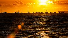 """Orange sunset Go to http://iBoatCity.com and use code PINTEREST for free shipping on your first order! (Lower 48 USA Only). Sign up for our email newsletter to get your free guide: """"Boat Buyer's Guide for Beginners."""""""