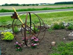 """Cathy Scott's rusty orb. Cathy Scott says, """"I'm working on my Orb garden … I have to figure out what to do with my Sundial."""""""