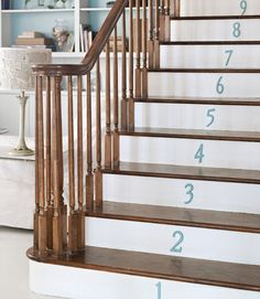 Numbered stairs: As easy as painting plain brass house numbers with aqua paint. #diyprojects