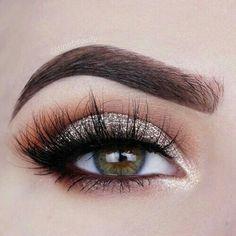 Gold glitter and bronze makeup