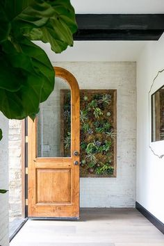 An arched front door with a single glass panel opens to light gray wash wood floors leading to a white framed mirror hung from a white wall. Glass Panel Door, Glass Front Door, Glass Panels, Interior Exterior, Exterior Design, Interior Door, Arched Front Door, Interior Design Boards, Tadelakt