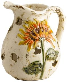 Scenterrific W510003 Sunflower Vase Decorative Ceramic Fragrance Warmer by Scenterrific. $29.99. Scenterrific started with an idea to produce a safe and wickless alternative to scented candles. Each beautiful ceramic is glazed and comes with an easy to program timer. The three flickering LEDs provide a warm and inviting ambiance without the dangers of an open flame. The Scenterrific warming plate is safe to touch. Just place your favorite disk onto the warmer and you are done....