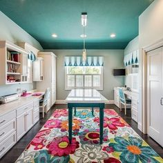 This room speaks to me— from the turquoise ceiling to the white cabinets to the center island to the cheerful rug. Craft Room Tables, Ikea Craft Room, Craft Room Design, Home Design Diy, Home Office Design, Home Remodeling Contractors, Basement Remodeling, Remodeling Ideas, Best Ikea