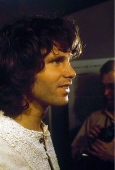 Jim Morrison, just because he is smiling.