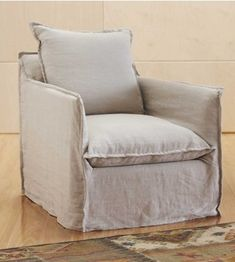 Removable linen slipcover. The flanges are a nice touch. Slightly scaled-down chair for smaller spaces.