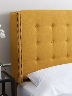 Abbyson Living Callista Tufted Headboard. This luxuriously upholstered headboard features exquisite detailing accented with distinctive tufting and brass nailhead trim; bed rails and mattress sold separately