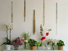 I've been meaning to nail some hooks above my dresser... here's inspiration for what may go below.
