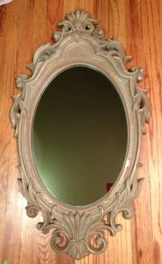 Antique mirror hand painted in Annie Sloan chalk paint duck egg blue, second coat was Annie Sloan chalk paint coco painted randomly with a chip brush, distressed to show gold undertones, clear & dark waxed.  A beautiful patina finish.