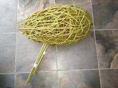 Willow bird Stage 2 Once you've woven about 7 rods into your frame tip first you can start free weaving butt end first. Weaving over and under will hold the rod in place. it tends to look naff but keep going - leap of faith stage! Once 20-30 rods have been woven into your frame you can make a U- shaped pin of the legs. This is typically a really thick willow rod, or in this case two thinner rods bound together. Push the pin in at the top if the body wedging it