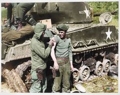 "#TheForgottenWarInColor ..... M4A3E8 ""Easy Eight"" Sherman tank named ""RICE'S RED DEVILS"" - Nº61938 is stencilled on the side. 12 March 1951 (possibly the 89th Medium Tank Battalion at the Han River, Korea.) A Medic gives Smallpox jabs to the tank crew. There was a smallpox re-vaccination of front-line soldiers done at the height of the smallpox epidemic of Jan-April 1951, which occurred during a major US offensive. ..."