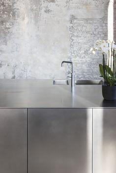 + Chrome kitchen meets worn wall ...