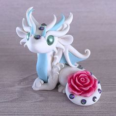 White-Rose-Dragon-Sculpture-by-Dragons-and-Beasties