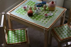 Quilted chair pads and a matching tablecloth add definition to a cookie cutter children's chairs and table.