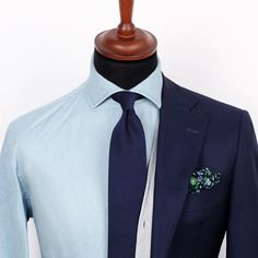 Dapper and formal, yet creative - the soon-to-be released Denim shirt and Dark blue wool tie paired with an Indigo floral pocket square.  www.Grandfrank.com