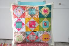 fabulous pillow- love everything about it- the colors, the fussy cuts, such great fabric! @Tamiko Percell