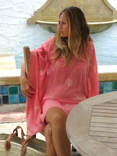 Gorgeous cover-up in coral tones silk with hand done gold block print. Also comes with a matching tie sash to wear it belted. Add  a little slip and wear it as a fabulous mini. imported, a CJ Laing exclusive. Dry clean. Available in small or extra small.