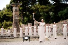 Actress Ino Menegaki, acting as high priestess holds the torch carrying the Olympic Flame on May 10, 2012 during the lighting ceremony in ancient Olympia the sanctuary where the Olympic Games were born in 776 B.C.