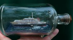 Andrea Doria show after collision with huge hole in her starboard side. Ship in a Bottle