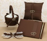 """All my heart collection with mocha, satin pillow with satin ribbon accents and gold-plated, rhinestone heart brooches.  4-Piece set includes: 8"""" tall Flower basket (Petals not included), 8""""x8"""" ring pillow, 9 1/2""""x6 1/2"""" guest book (Records 500 signatures), and 3 3/4""""x3 3/4"""" base pen set (Writes in black ink). www.CreativeWeddingStyle.com $124.99"""