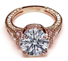 Cathedral Graduated pave Engagement Ring In Rose Gold.