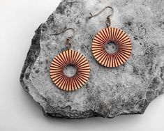 This is one of my favorite earrings because they have made from reclaimed old wood. Hand-formed with red, green and black radial lines to give a more kinetic feel. They will be perfect with a t-shirt and jeans or dressed up for an event. Wooden Earrings, Earrings Handmade, Handmade Chandelier, Circle Shape, T Shirt And Jeans, Old Wood, Chandelier Earrings, Red Green, Copper