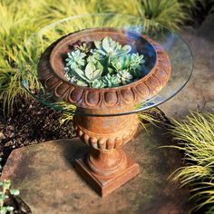Urn as patio table – or container for a living bouquet